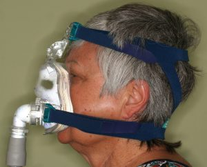 Woman Using CPAP Machine